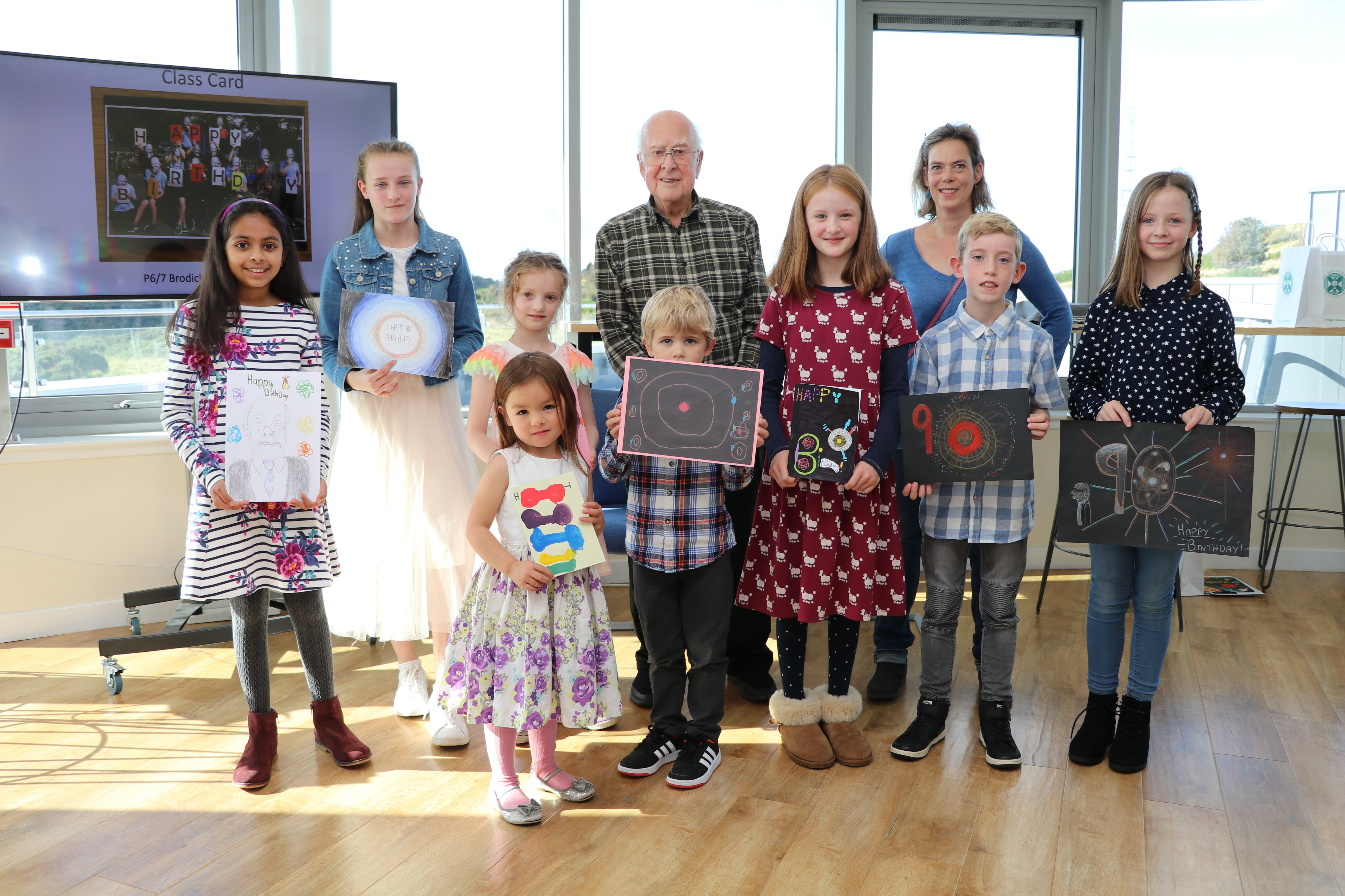 Photograph of Peter Higgs with schoolchildren at a prizegiving event at the Royal Observatory, Edinburgh on 28 Sept 2019